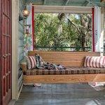 The Carriage House boasts a wrap around veranda.