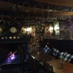 log fire and tables at Crows Nest