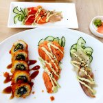 Tempura roll, salmon sashimi, sea bass sashimi, and mixed sashimi plate at Sakke