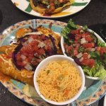 Steak Enchiladas - main course with salad and rice