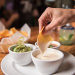 "Our ""Tres Hombres"" Sampler – a sharable dipper best enjoyed with a margarita pitcher + good frie"