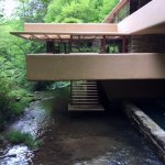 Cantilevered living room over stairway to waters