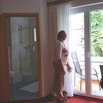 Sliding glass doors to balcony, bath in corner.