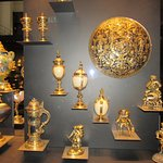collections of figurines and treasures decorated in cold and enamels