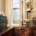 Details of original copper tubs encased in walnut can be enjoyed in 4 guest rooms.