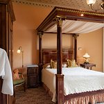 While in Corinne's Room, rest in the Philadelphia Empire queen bed with full canopy.