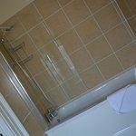Large bathroom with jacuzzi bath