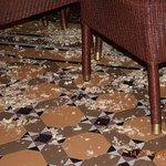 Floor littered with monkeynut shells