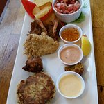 Appetizer sampler plate (GREAT conch fritters) and delicious sauces for each one