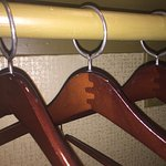 Inconvenient locked-on hangers and useless ginormous open shelf closet