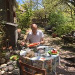 Preparing lunch on the shadowy terras in front of our room.