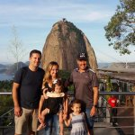 Travelers at the Urca hill with the Sugar Loaf mountain in the background