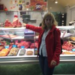 Patrizia pointing out the beefsteak in the market