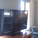 "room 2310 studio 40"" flat screen tv next to living room"