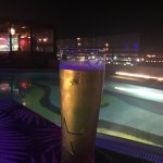 Quiet beer by the roof top pool at night