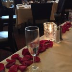 Rose petals lined the front of our table with complimentary champagne for our anniversary.