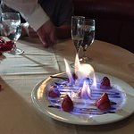 Complimentary flaming strawberries flambé