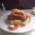 Breakfast croissant - bacon, scrambled egg, aubergine