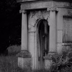 A black and white shot of a crypt, it was in a separate part of the graveyard.