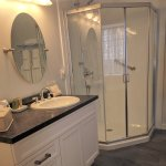 Cartier newly renovated ensuite with walk in corner shower and claw foot tub