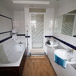 Bath, shower & 2 basins in Room 108 (tatty bath panels a shame)