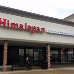front of & entrance to Himalayan
