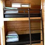 Deluxe Studio cabin with bathroom. Sleeps up to 4. Small room with bunk beds. Bedding is provide