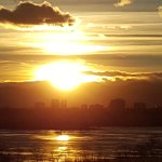 Sunset across Cherry Creek Lake, shadows of Denver with Rocky Mts in distance!