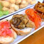 Marinated vegetables on sliced bread