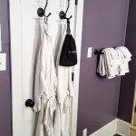 Toilet room door, with hairdryer & robes