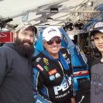 My son and grandson with John Force.