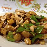 Kung Bo Chicken - chinese vegetables in a dark, kung bo sauce topped with roasted cashews.