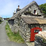 Thatched outhouse.