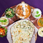 Executive Lunch Premium Thali of 7 flavorful dishes and freshly baked Naan bread