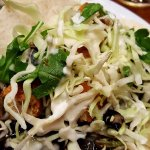 "Korea Town tacos - ""chicken"" (delicious), cabbage, avocado, cilantro, black beans and more"