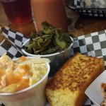 Left side shows the squash casserole and collard greens. Center is corn bread. Pork on right.