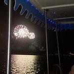 Enjoying the fireworks of magic kingdom on a boat ride