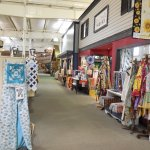 Quilts for sale, a fabric shop and further down a delightful kitchen shop and a toy store.