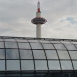Kyoto Tower view from room peeking out over Kyoto Station roof.