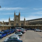 The train station with the bristol blue taxis.