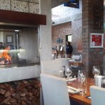 Fireplace in centre of restaurant