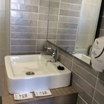 Sink,quality taps,soap dispenser & large mirror.