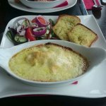 The Seafood Lasagna, served with garlic bread and salad.
