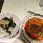 grape leaves side dish; meatball main dish with potatoes
