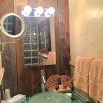 Avila experience bathroom ,mix old barn wood with beautiful glass tile