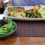 Chicken and ham pie with vegetables and mash.