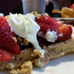 Granola Crunch Waffle with strawberries and whipped cream