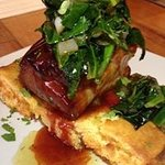 Crispy Pork Belly over Jalapeno Corn Bread with Braised Collard Greens