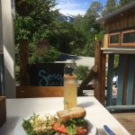 Salmon burger on gluten free bread served with a view from the patio