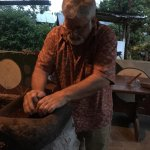 Grinding up the roasted cacao beans